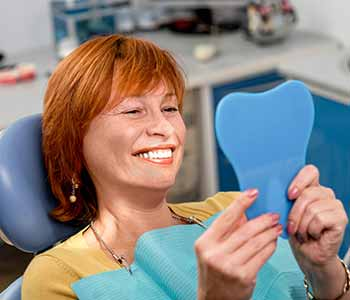 Lauderdale explains how to care for dental implants